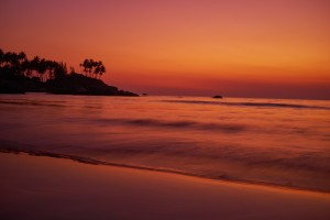 Calm peaceful ocean and beach on tropical sunrise. Bali, Indonesia